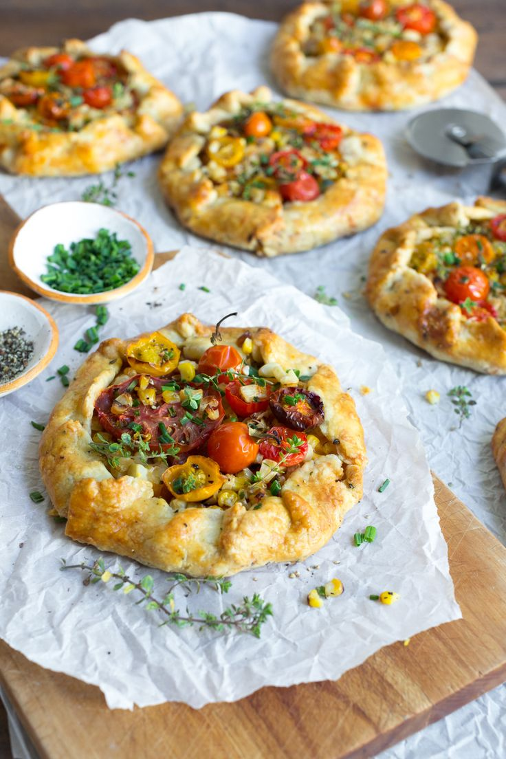 Summer in every bite of these Heirloom Tomato & Grilled Corn Galettes with Cheddar Crust. by @beckysuebakes