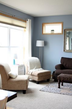 Grey-blue walls, maple trim, white accents