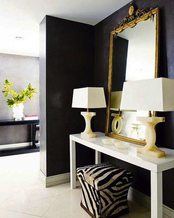 If the stairs open into the family - this type of set up could work for the entryway - table, mirror, lamps