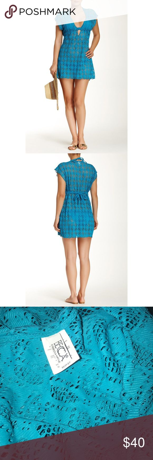 """BECCA Ritual Crochet Tunic Swim Cover-up Dress New BECCA Teal Blue Ritual Crochet Tunic Swim Cover-up Mini Dress Size XS/S   Slip on this sheer crochet tunic for just the right amount of beach or poolside coverage. - V-neck - Short sleeves - Back tie closure - Sheer crocheted construction - Approx. 33"""" length  Fiber Content 92% nylon, 8% spandex   Hand wash cold Additional Info Fit: this style fits true to size.  Model's stats for sizing: - Height: 5'7"""" - Bust: 32"""" - Waist: 24"""" - Hips: 34""""…"""
