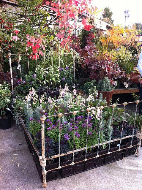Gardening bedGardens Ideas, Gardens Beds, Beds Frames Hmmm, Old Beds Frames, Flower Gardens, Fleas Marketing Finding, Flower Beds, Garden Beds, Yards