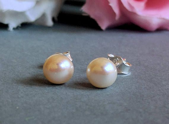 The classic real freshwater pearl earrings on 925 sterling silver stud! The pearls have a very nice round shape and its high quality AAA graded pearl. The size of the pearls are 6mm. Simple and beautiful, you can wear them on a very important event but its also a perfect everyday jewelry. This item includes 1 pair of earrings. The metal part is 925 sterling silver, its perfect even if you are sensitive for metals. The earrings will be packaged in a beautiful gift box as you...