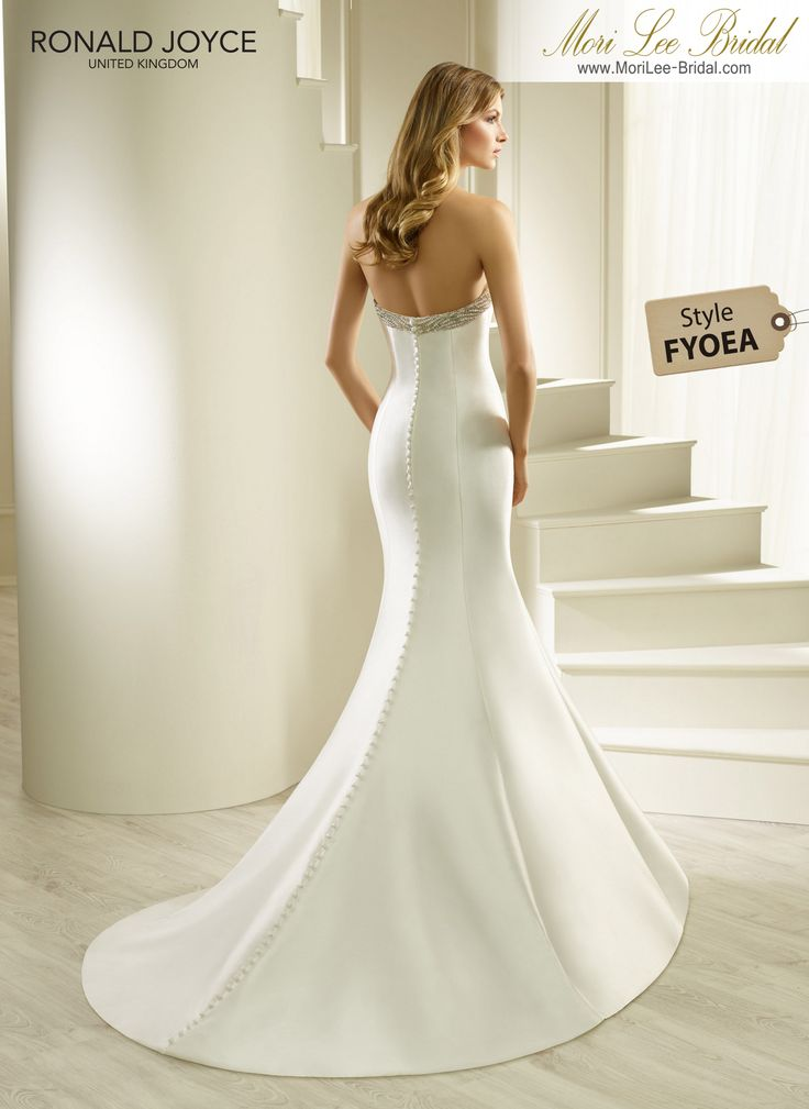 Style FYOEA HEVA AN ELEGANT STRAPLESS MIKADO FISHTAIL DRESS WITH A BEADED SWEETHEART NECKLINE AND BACK BUTTON DETAIL. PICTURED IN IVORY.COLOURSWHITE, IVORY