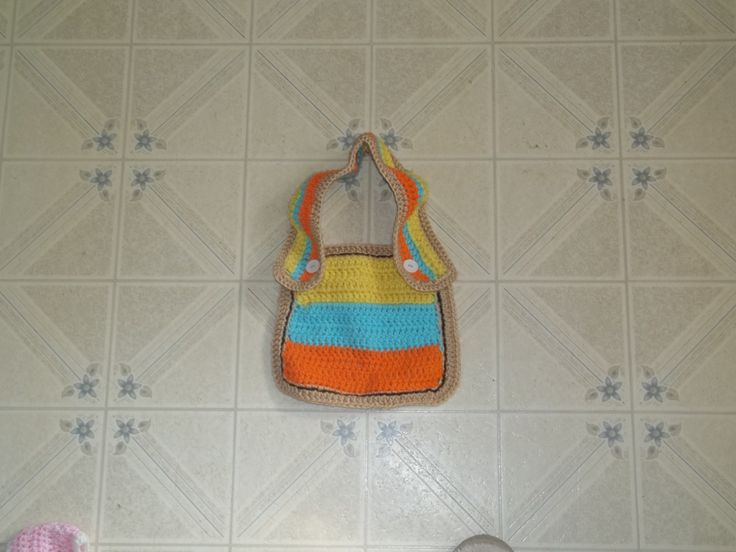 a new bib. This one has adjustable straps. nice big bib portion for those messy days. Absorbent and machine washable.