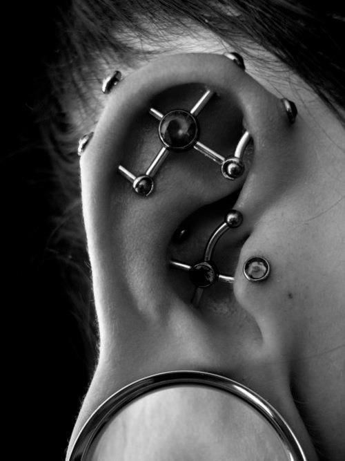 Extreme Tragus Piercings ~ http://tattooeve.com/the-tragus-piercing-for-strong-woman/ Piercing