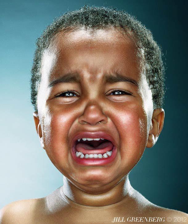 Photographer Jill Greenberg makes small children cry stealing their lollipops