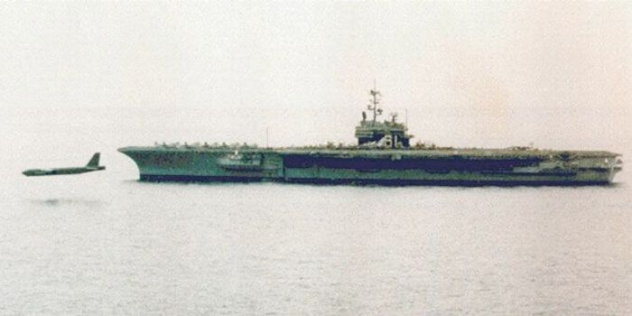 A B-52 slides down the port side of USS Ranger (CV-61)