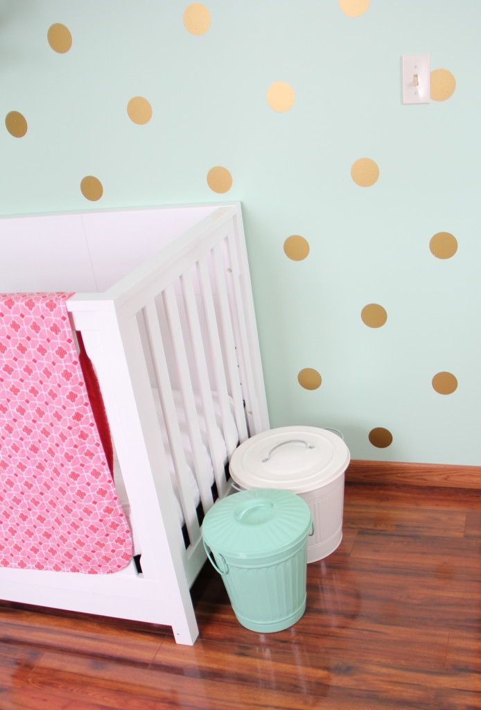 This week's readers' favorite is a fabulous mint, coral and gold nursery. Check out the gold polka dot decals on the pretty mint-colored walls—so chic!