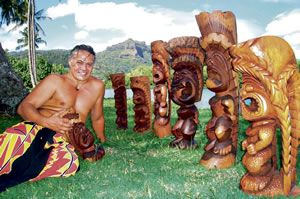 Kauai artist Keoni Durant, surrounded by tikis he carved for the Wailua Marina Restaurant, Kauai's only riverfront restaurant, and a favorite local surf and turf spot (BYOB). Photo by Coco Zickos.