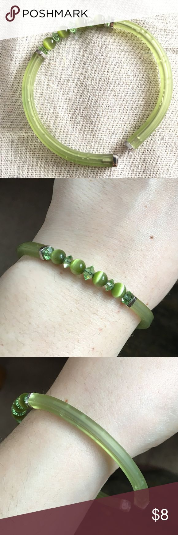 Genuine Swarovski Crystal Jelly Bracelet Green Swarovski jelly bracelet with Swarovski beads. Ends of the bracelet have the Swarovski swan stamp as seen in picture. Jelly part is damaged, has indentations and puncture marks. Still looks nice! Swarovski Jewelry Bracelets