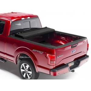 BAKFlip MX4 tonneau cover is available for your truck at RealTruck. This hard-folding matte black truck bed cover provides a flush fit. Shop now or call 877-216-5446.