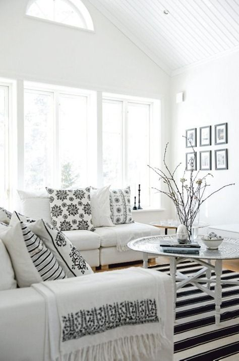 Simple black and white decor. Restful white room with high ceiling and touches of black in patterned fabrics  www.mulberryinteriors.ca