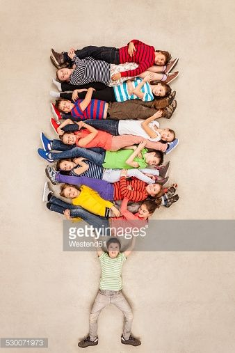 Stock Photo : Boy carrying all his friends piled up