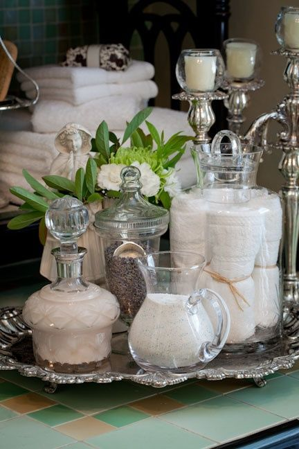 Nell Hill- take your glassware and fill it with bathsalts, Qtips, cotton balls etc. Put platter under it. Looks fancy for the cost of zero- Dailee Phillips