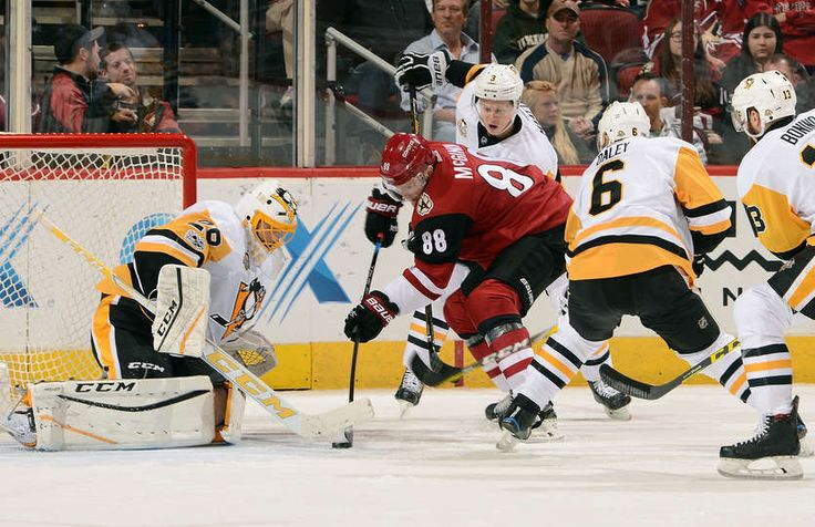 Coyotes vs. Penguins - 02/11/2017 - Pittsburgh Penguins - Photos Goalie Marc-Andre Fleury #29 of the Pittsburgh Penguins looks to make a save as Jamie McGinn #88 of the Arizona Coyotes skates in with the puck between Olli Maatta #3 and Trevor Daley #6