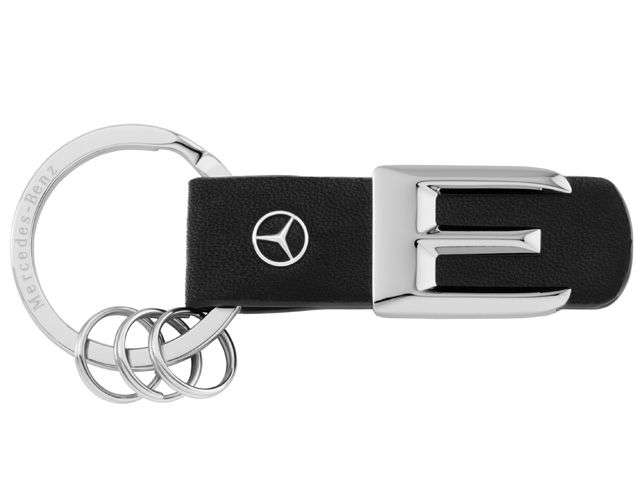 B66957943  Model series key ring. Black/silver. Leather/stainless steel.  Scale replica of lettering on rear of vehicle. Laser-engraved flat split ring.  3 mini split rings for quick replacement of keys. Star logo stud in leather.
