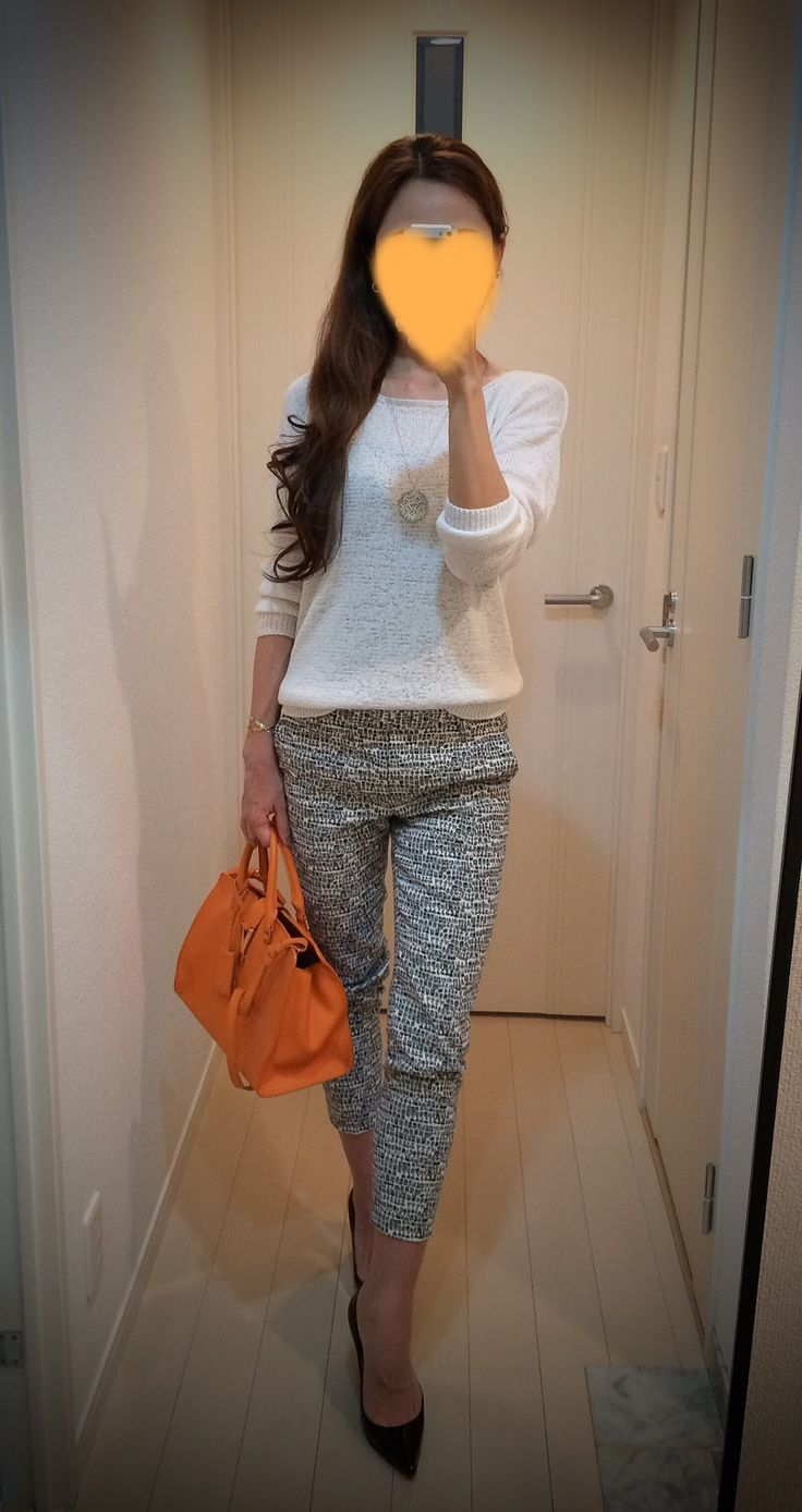 Top: Rie Miller Pants: Tomorrowland Bag: Saint Laurent Heels: Christian Louboutin