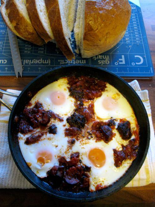 eggs in chorizo, black pudding & tomatoes