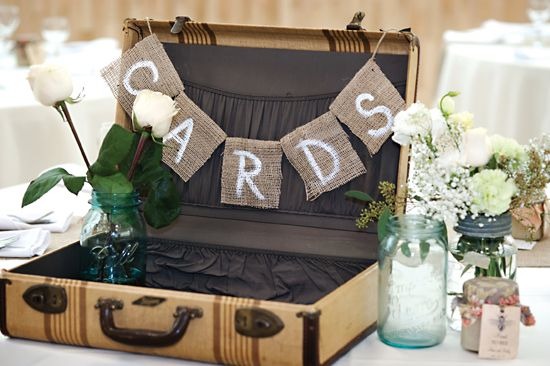 Vintage suitcase card box with burlap garland.    Photography by Lisa Klassen.