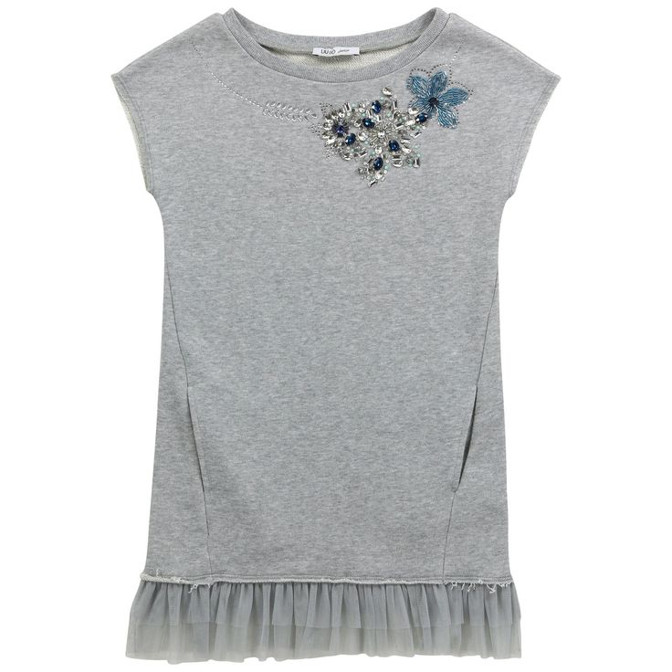 Mottled grey glitter dress made of fleece. Tulle patches at the hem. Round neckline and short sleeves. Rhinestones, paste studs and stones on the neckline. Side pockets. - $ 117,60