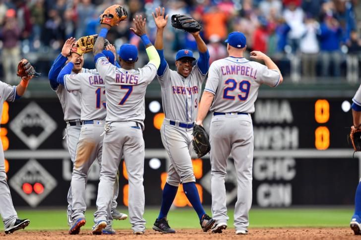New York Mets right fielder Curtis Granderson (center) celebrates with left fielder Michael Conforto (30), shortstop Asdrubal Cabrera (13), third baseman Jose Reyes (7) and first baseman Eric Campbell (29) after clinching a wild-card playoff berth after a game against the Philadelphia Phillies at Citizens Bank Park.