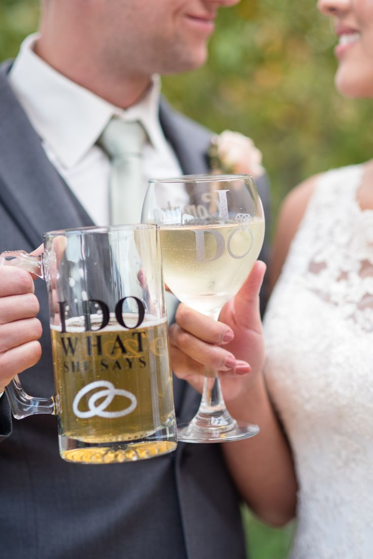 "Funny wedding day glasses for the bride and groom: ""I do"" and ""I do what she says"" (Maura Jane Photography)"