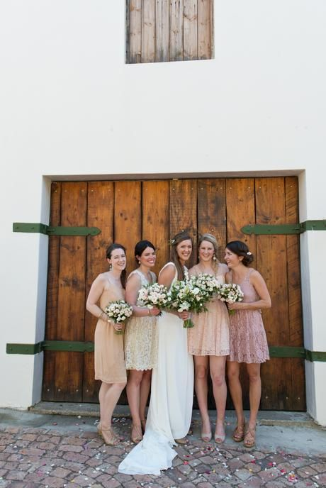 Cream, blush and peach rustic wedding. Bridesmaids in different shade and styles of dresses