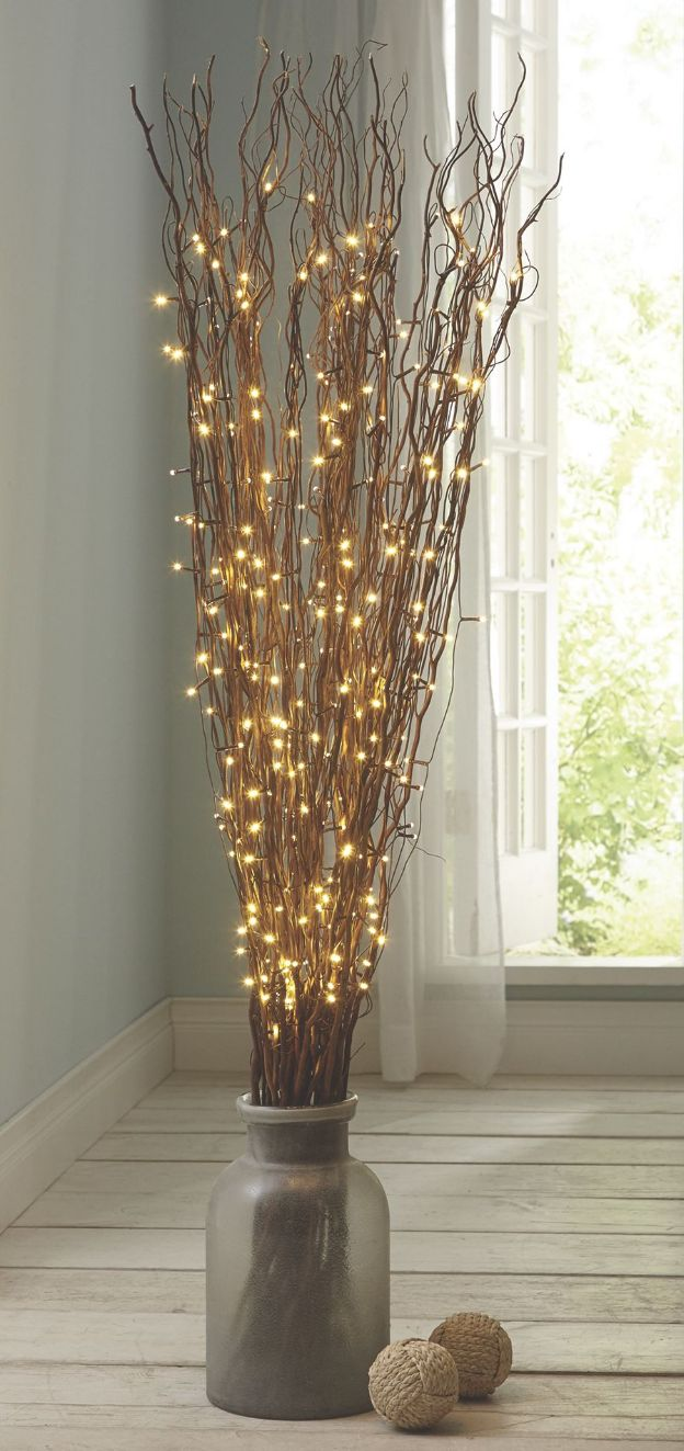 Fill a substantial floor vase with a tall arrangement of LED branches. It's another beautiful way to add a subtle glow to the area.