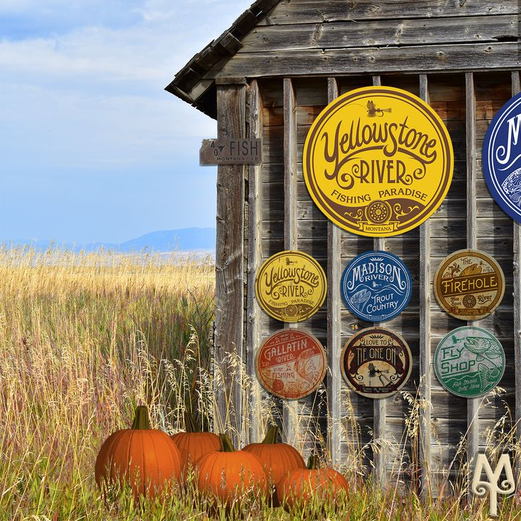 Vintage and New fly fishing wall signs hang on a rustic barn in Bozeman, Montana. Collect all of the signs on the Montana Treasures web site, today!