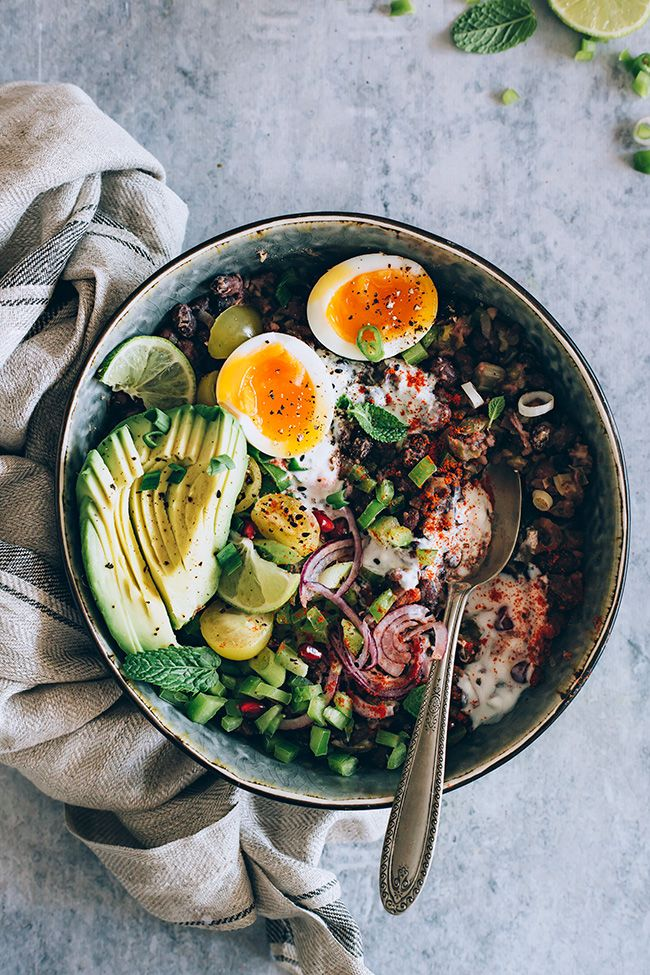 nourishing black bean stew with avocado and egg.