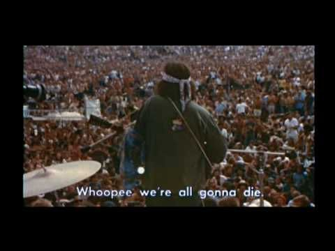 """Country Joe McDonald performs his big hit """"I-feel-like-I'm-fixing- to-die-rag"""" (The Viet Nam song) live at Woodstock. He manages to get 300,000 people singing to stop the war in Viet Nam. This Woodstock Hero is still touring, now fighting against a new war in Iran. Visit his homepage for more music and info."""