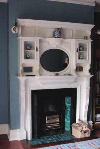 Edwardian wooden fire surround & tiled hearth. I'll take this in black or dark wood, please!
