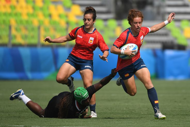 Kenya's Philadelphia Olanda (LOWER) tackles Spain's Barbara Pla in the womens rugby sevens match between Spain and Kenya during the Rio 2016 Olympic Games at Deodoro Stadium in Rio de Janeiro on August 7, 2016. / AFP / Pascal GUYOT