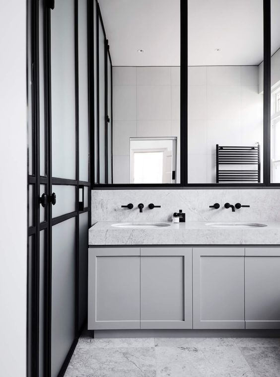 tap faucets out of wall and bright mirrored surfaces