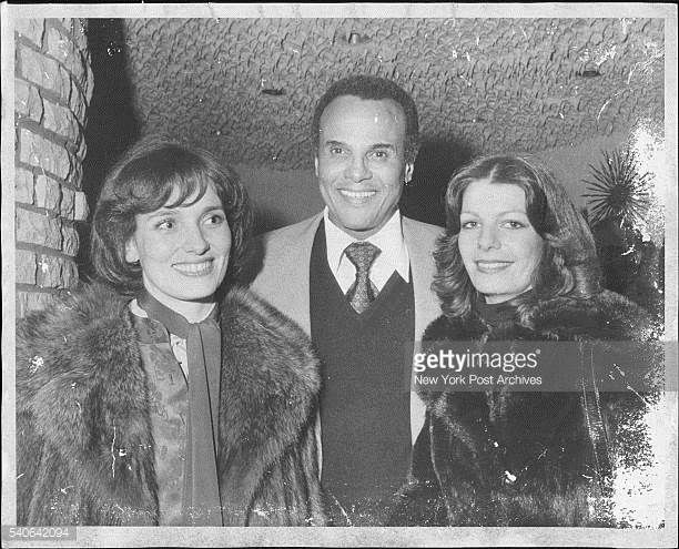 Genial Host Harry Belafonte mingles with a couple of the guests at a party he threw at Sirocco last night Margaret Trudeau wife of the Canadian prime...