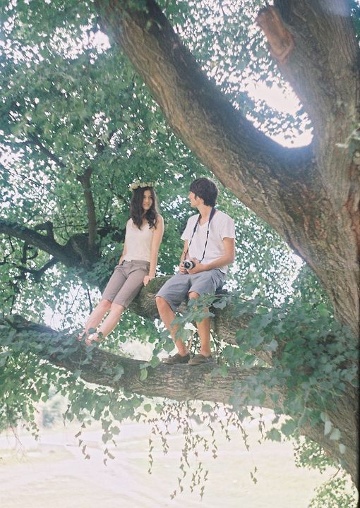 couple sitting on a tree branch