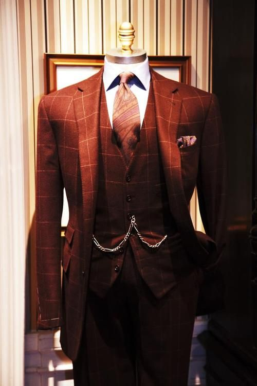 Character: Harrison Devaux his style of suit. Unusual for him to wear burnt red, but it's muted and close to brown, so he'd wear it.