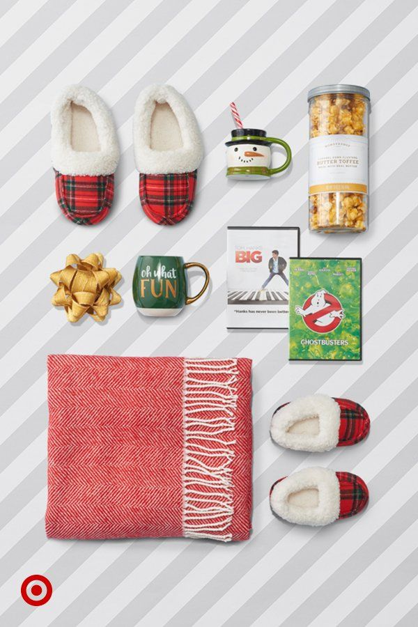Make movie night extra cozy with a soft throw, plaid slippers plus Big & Ghostbusters on DVD.