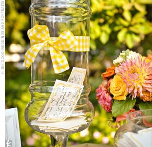 "Perfect sentiment for a love of cooking- ""Instead of a guest book, the couple asked for notes on ""the recipe for a happy marriage."" Guests dropped them in an apothecary jar dressed up with checkered ribbon."""