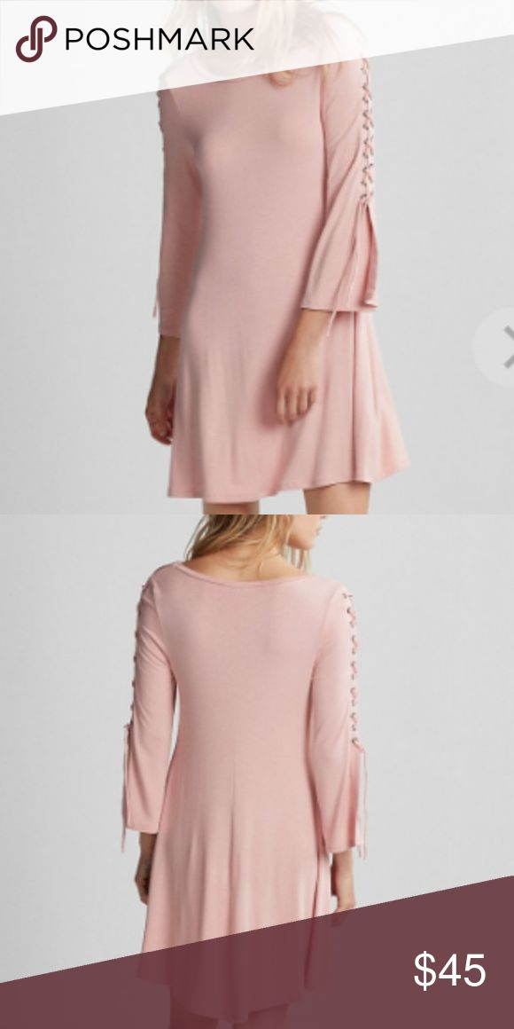NWT Lace Up Shoulder Shift Dress Blush Pink Brand new with tags Lace Up Shoulder Shift Dress in Blush Pink. Get in on the lace-up trend with this trapeze dress featuring eye-catching corset inspiration on the sleeves. Made from so-smooth, stretchy rayon knit, the swing and sway of this beauty has flair for days. Perfect when paired with leggings or tights and boots and a long duster vest. Awesome for spring and warmer weather too. Soft, stretchy and comfortable. Wear casually or dress up…
