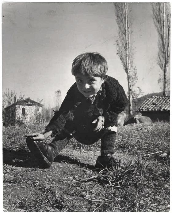 [Elefteria touching her new pair of shoes, Oxia, Greece]-David Seymour,1949