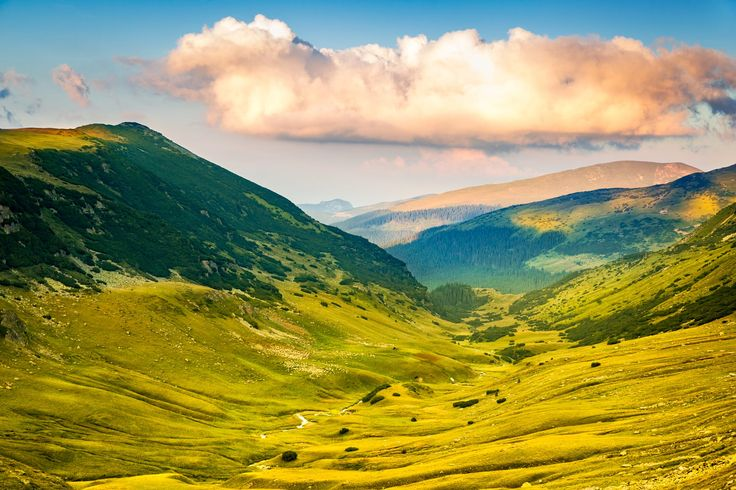 Valley along the mountain peaks crossed by Transalpina road, at Urdele pass, in Valcea county, Romania