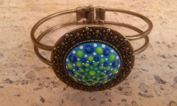 Check out this item in my Etsy shop https://www.etsy.com/listing/472255895/nickel-free-bronze-dotillism-art-cuff