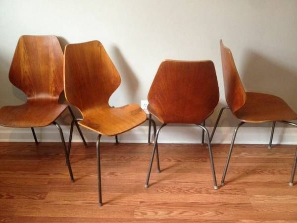 Set Of Four Moulded Ply Teak Stackable Dining Chairs With Coated Steel Tubular Legs 320