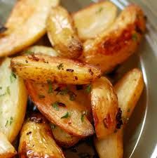 Oven Roasted fries - Gordon Ramsay - Cut 2 large baking potatoes into wedges 3/4 inch thick. - Add to a pan of boiling water and blanch for 4 minutes. Drain well. - Return to dry pan, add 2tbsp olive oil and shake pan to coat fries. - Spread fries on baking sheet and bake at 400F for 10 minutes. - Shake the sheet to turn again and bake for 10 to 15 minutes more. - Drain wedges on paper towels, season with salt and serve.  Yum!!