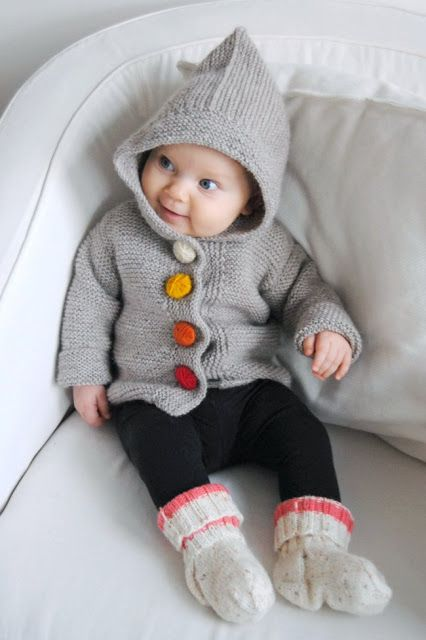 Knit baby jacket with knit-covered buttons, leggings, and knit socks