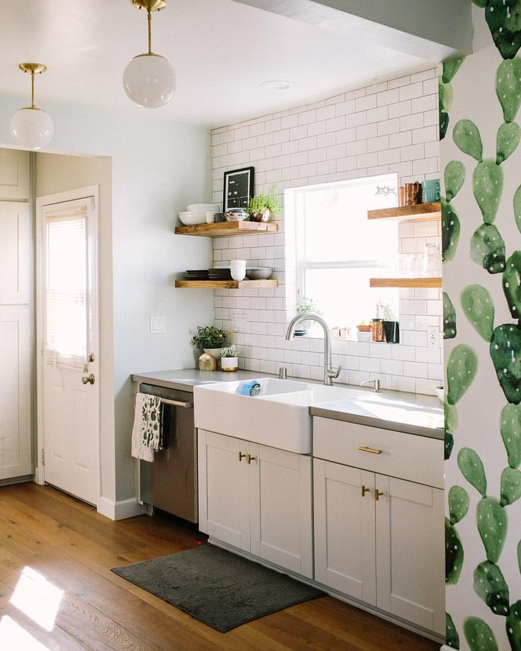 White Kitchen With Farmhouse Sink And Open Wood Shelving Plus Cactus Wallpaper