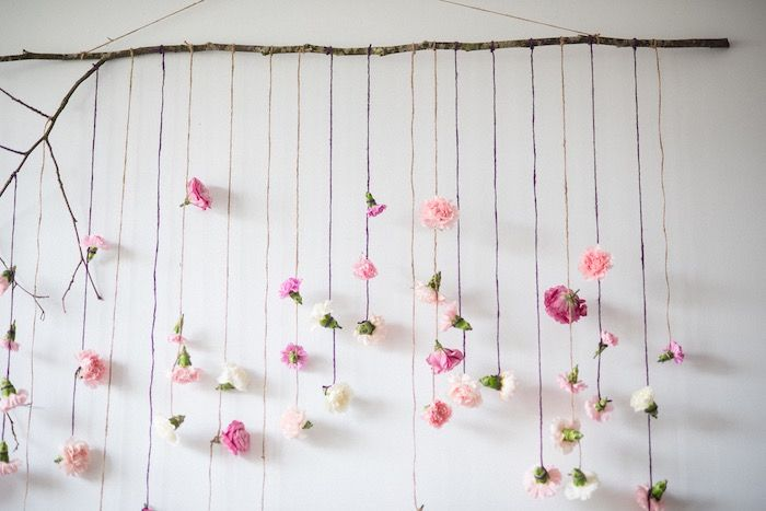 Flower garland backdrop from Boho & Bubbly Baby Shower at Kara's Party Ideas. See all the details at karaspartyideas.com!