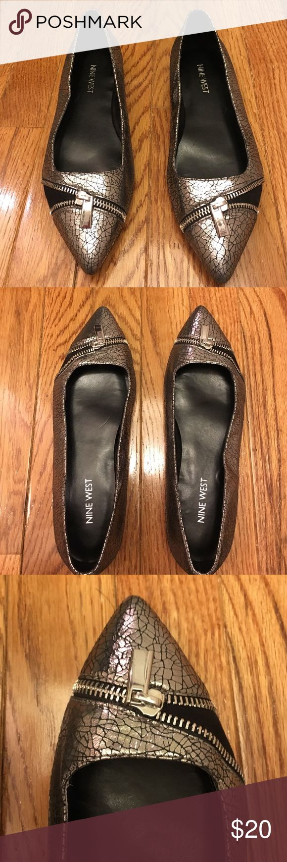 Fun Nine West silver flats Fun flats in this cool leather and textile Nine West shoe. Silver and black with zipper detailing. A bit of the silver is coming off on bottom of side of left shoe - hard to see when wearing - see last pic for close up. Nine West Shoes Flats & Loafers