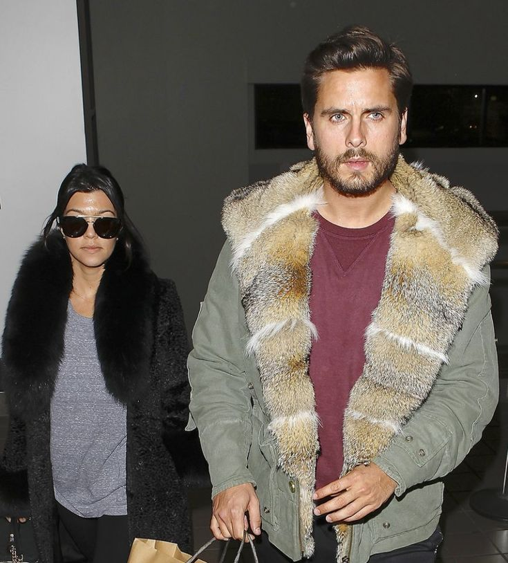 <p>Reality star Scott Disick wore a green jacket with fur trim at LAX airport on Feb. 24, 2014. His traveling companion, Kourtney Kardashian, opted for a black fur jacket. (Photo: Splash News) </p>